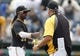 Sep 19, 2013; Pittsburgh, PA, USA; Pittsburgh Pirates center fielder Andrew McCutchen (22) is greeted by manager Clint Hurdle (right) after defeating the San Diego Padres at PNC Park. The Pittsburgh Pirates won 10-1. Mandatory Credit: Charles LeClaire-USA TODAY Sports