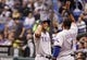 Sep 19, 2013; St. Petersburg, FL, USA; Texas Rangers right fielder Alex Rios (51) is congratulated by shortstop Elvis Andrus (1) after he hit a solo home run during the third inning against the Tampa Bay Rays at Tropicana Field. Mandatory Credit: Kim Klement-USA TODAY Sports