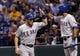 Sep 19, 2013; St. Petersburg, FL, USA; Texas Rangers second baseman Ian Kinsler (5) high fives right fielder Alex Rios (51) after he scored during the fourth inning against the Tampa Bay Rays at Tropicana Field. Mandatory Credit: Kim Klement-USA TODAY Sports