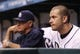 Sep 19, 2013; St. Petersburg, FL, USA; Tampa Bay Rays third baseman Evan Longoria (right) and manager Joe Maddon (left) watch from the dugout against the Texas Rangers at Tropicana Field. Texas Rangers defeated the Tampa Bay Rays 8-2. Mandatory Credit: Kim Klement-USA TODAY Sports