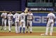 Sep 19, 2013; St. Petersburg, FL, USA; Texas Rangers center fielder Craig Gentry (23), second baseman Ian Kinsler (5) and teammates high five after they beat the Tampa Bay Rays at Tropicana Field. Texas Rangers defeated the Tampa Bay Rays 8-2. Mandatory Credit: Kim Klement-USA TODAY Sports
