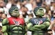 Sep 15, 2013; Houston, TX, USA; Houston Texans fans dressed as the Hulk watch a replay in the fourth quarter against the Tennessee Titans at Reliant Stadium. The Houston Texans beat the Tennessee Titans 30-24 in overtime. Mandatory Credit: Matthew Emmons-USA TODAY Sports