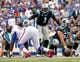 Sep 15, 2013; Orchard Park, NY, USA; Carolina Panthers quarterback Cam Newton (1) signals a play during the game against the Buffalo Bills at Ralph Wilson Stadium. Mandatory Credit: Kevin Hoffman-USA TODAY Sports