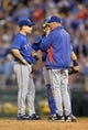 Sep 20, 2013; Kansas City, MO, USA; Texas Rangers pitching coach Mike Maddux (right) talks with pitcher Jason Frasor (left) against the Kansas City Royals during the eighth inning at Kauffman Stadium. The Royals defeated the Rangers 2-1. Mandatory Credit: Peter G. Aiken-USA TODAY Sports