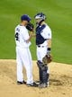 Sep 20, 2013; San Diego, CA, USA; San Diego Padres catcher Nick Hundley (4) talks with starting pitcher Robbie Erlin (41) during the fourth inning against the Los Angeles Dodgers at Petco Park. Mandatory Credit: Christopher Hanewinckel-USA TODAY Sports