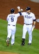 Sep 20, 2013; San Diego, CA, USA; San Diego Padres second baseman Jedd Gyorko (9) is congratulated by third baseman Chase Headley (7) after a solo home run during the fifth inning against the Los Angeles Dodgers at Petco Park. Mandatory Credit: Christopher Hanewinckel-USA TODAY Sports
