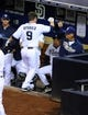 Sep 20, 2013; San Diego, CA, USA; San Diego Padres second baseman Jedd Gyorko (9) is congratulated by manager Bud Black (20) after a solo home run during the fifth inning against the Los Angeles Dodgers at Petco Park. Mandatory Credit: Christopher Hanewinckel-USA TODAY Sports