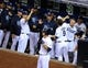 Sep 20, 2013; San Diego, CA, USA; San Diego Padres second baseman Jedd Gyorko (9) is congratulated by teammates after a solo home run during the fifth inning against the Los Angeles Dodgers at Petco Park. Mandatory Credit: Christopher Hanewinckel-USA TODAY Sports