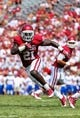 Sep 14, 2013; Norman, OK, USA; Oklahoma Sooners running back Keith Ford (21) runs with the ball during the game against the Tulsa Golden Hurricane at Gaylord Family - Oklahoma Memorial Stadium. Oklahoma won 51-20. Mandatory Credit: Kevin Jairaj-USA TODAY Sports