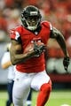 Sep 15, 2013; Atlanta, GA, USA; Atlanta Falcons wide receiver Julio Jones (11) runs after a catch in the game against the St. Louis Rams at the Georgia Dome. The Falcons won 31-24. Mandatory Credit: Daniel Shirey-USA TODAY Sports
