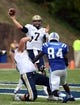 Sep 21, 2013; Durham, NC, USA;  Pitt Panthers quarterback Tom Savage (7) throws the ball during the first half as Duke Blue Devils  defensive end Kenny Anunnike (84) pressures him at Wallace Wade Stadium. Mandatory Credit: Rob Kinnan-USA TODAY Sports