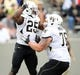 Sep 21, 2013; West Point, NY, USA; Wake Forest Demon Deacons running back Josh Harris (25) celebrates his rushing touchdown with offensive guard Tyler Hayworth (78) during the second half at Michie Stadium. Mandatory Credit: Danny Wild-USA TODAY Sports