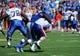 Sep 21, 2013; Lawrence, KS, USA; Kansas Jayhawks defensive lineman Keba Agostinho (96) sacks Louisiana Tech Bulldogs quarterback Ryan Higgins (14) in the second half at Memorial Stadium. Kansas won 13-10. Mandatory Credit: John Rieger-USA TODAY Sports