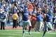 Sep 21, 2013; Lawrence, KS, USA; Kansas Jayhawks defensive lineman Keon Stowers (98) celebrates after recovering a fumble against the Louisiana Tech Bulldogs in the second half at Memorial Stadium. Kansas won 13-10. Mandatory Credit: John Rieger-USA TODAY Sports