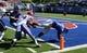 Sep 21, 2013; Lawrence, KS, USA; Kansas Jayhawks tight end Jimmay Mundine (41) scores a touchdown against Louisiana Tech Bulldogs defensive back Xavier Woods (39) in the second half at Memorial Stadium. Kansas won 13-10. Mandatory Credit: John Rieger-USA TODAY Sports