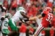 Sep 21, 2013; Athens, GA, USA; North Texas Mean Green defensive back Marcus Trice (8) blocks a punt by Georgia Bulldogs punter Collin Barber (32) that gets recovered for a touchdown during the second half at Sanford Stadium. Georgia defeated North Texas 45-21. Mandatory Credit: Dale Zanine-USA TODAY Sports