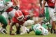 Sep 21, 2013; Athens, GA, USA; Georgia Bulldogs running back Todd Gurley (3) is tackled by North Texas Mean Green defensive back Lairamie Lee (27) during the second half at Sanford Stadium. Georgia defeated North Texas 45-21. Mandatory Credit: Dale Zanine-USA TODAY Sports