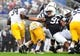 Sep 21, 2013; University Park, PA, USA; Penn State Nittany Lions defensive tackle DaQuan Jones (91) reaches to try to tackle Kent State Golden Flashes running back Trayion Durham (34) at Beaver Stadium. Mandatory Credit: Evan Habeeb-USA TODAY Sports