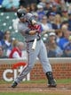 Sep 21, 2013; Chicago, IL, USA; Atlanta Braves third baseman Chris Johnson (23) hits a single in the second inning against the Chicago Cubs at Wrigley Field. Mandatory Credit: Dennis Wierzbicki-USA TODAY Sports
