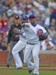 Sep 21, 2013; Chicago, IL, USA; Chicago Cubs third baseman Luis Valbuena (24) throws out Atlanta Braves catcher Gerald Laird (not pictured) in the fourth inning at Wrigley Field. Mandatory Credit: Dennis Wierzbicki-USA TODAY Sports