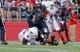Sep 21, 2013; Piscataway, NJ, USA;  Rutgers Scarlet Knights quarterback Gary Nova (10) is sacked by Arkansas Razorbacks defensive end Chris Smith (42) during the first half at High Points Solutions Stadium. Mandatory Credit: Jim O'Connor-USA TODAY Sports