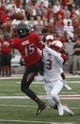 Sep 21, 2013; Oxford, OH, USA; Miami (Oh) Redhawks defensive back Dayonne Nunley (3) breaks up a pass intended for Cincinnati Bearcats wide receiver Chris Moore (15) during the second quarter at Fred Yager Stadium. Mandatory Credit: David Kohl-USA TODAY Sports