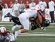 Sep 21, 2013; Oxford, OH, USA; Miami (Oh) Redhawks defensive back Jay Mastin (14) tackles Cincinnati Bearcats wide receiver Chris Moore (15) during a game at Fred Yager Stadium. Mandatory Credit: David Kohl-USA TODAY Sports