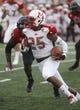 Sep 21, 2013; Oxford, OH, USA; Miami (Oh) Redhawks wide receiver Dawan Scott (25) runs against Cincinnati Bearcats linebacker Solomon Tentman (33) at Fred Yager Stadium. Mandatory Credit: David Kohl-USA TODAY Sports