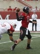 Sep 21, 2013; Oxford, OH, USA; Cincinnati Bearcats quarterback Brendon Kay (11) looks to throw with pressure by Miami (Oh) Redhawks defensive lineman Wes Williams (9) during the second quarter at Fred Yager Stadium. Mandatory Credit: David Kohl-USA TODAY Sports