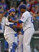 Sep 21, 2013; Chicago, IL, USA; Chicago Cubs relief pitcher Pedro Strop (right) is congratulated by catcher Dioner Navarro (left) for getting the final out in the ninth inning against the Atlanta Braves at Wrigley Field. Chicago won 3-1. Mandatory Credit: Dennis Wierzbicki-USA TODAY Sports