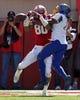 Sep 21, 2013; Lincoln, NE, USA; South Dakota State Jackrabbits defender Je Ryan Butler (22) breaks up a pass to Nebraska Cornhuskers receiver Kenny Bell (80) in the first quarter at Memorial Stadium. Nebraska won 59-20. Mandatory Credit: Bruce Thorson-USA TODAY Sports