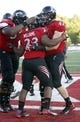 Sep 21, 2013; Oxford, OH, USA; Cincinnati Bearcats running back Hosey Williams (23) is congratulated by teammates after Williams scored a fourth quarter touchdown against the Miami (Oh) Redhawks at Fred Yager Stadium. Cincinnati won 14-0. Mandatory Credit: David Kohl-USA TODAY Sports