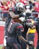 Sep 21, 2013; Piscataway, NJ, USA;  Rutgers Scarlet Knights teammates congratulate Janarion Grant (1) after his third quarter punt return for touchdown against the Arkansas Razorbacks  at High Points Solutions Stadium. Rutgers won 28-24. Mandatory Credit: Jim O'Connor-USA TODAY Sports