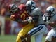 Sep 21, 2013; Los Angeles, CA, USA; Southern California Trojans safety Su'a Cravens (21) tackles Utah State Aggies running back Joe Hill (32) at the Los Angeles Memorial Coliseum. USC defeated Utah State 17-14. Mandatory Credit: Kirby Lee-USA TODAY Sports