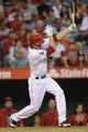 Sep 21, 2013; Anaheim, CA, USA; Los Angeles Angels second baseman Grant Green (10) hits a three RBI double against the Seattle Mariners during the second inning at Angel Stadium of Anaheim. Mandatory Credit: Kelvin Kuo-USA TODAY Sports