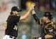 Sep 21, 2013; Pittsburgh, PA, USA; Pittsburgh Pirates relief pitcher Jason Grilli (39) and catcher Russell Martin (55) celebrate after defeating the Cincinnati Reds at PNC Park. The Pittsburgh Pirates won 4-2. Mandatory Credit: Charles LeClaire-USA TODAY Sports