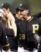 Sep 21, 2013; Pittsburgh, PA, USA; Pittsburgh Pirates relief pitcher Jason Grilli (39) receives a high-five as he comes off the field after earning a save against the Cincinnati Reds at PNC Park. The Pittsburgh Pirates won 4-2. Mandatory Credit: Charles LeClaire-USA TODAY Sports