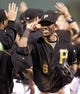 Sep 21, 2013; Pittsburgh, PA, USA; Pittsburgh Pirates left fielder Starling Marte (6) receives a high-five as he comes off the field after defeating the Cincinnati Reds at PNC Park. The Pittsburgh Pirates won 4-2. Mandatory Credit: Charles LeClaire-USA TODAY Sports