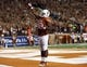 Sep 21, 2013; Austin, TX, USA; Texas Longhorns running back Johnathan Gray (32) celebrates his touchdown giving the Longhorn salute to the crowd against the Kansas State Wildcats during the third quarter of a football game at Darrell K Royal-Texas Memorial Stadium. Mandatory Credit: Jim Cowsert-USA TODAY Sports