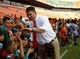 Sep 21, 2013; Miami Gardens, FL, USA;  Miami Hurricanes head coach Al Golden greets fans before a game against the Savannah State Tigers at Sun Life Stadium. Mandatory Credit: Robert Mayer-USA TODAY Sports