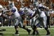 Sep 21, 2013; Austin, TX, USA; Kansas State Wildcats quarterback Jake Waters (15) fumbles against the Texas Longhorns during the fourth quarter of a football game at Darrell K Royal-Texas Memorial Stadium. The Longhorns won 31-21. Mandatory Credit: Jim Cowsert-USA TODAY Sports