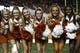 Sep 21, 2013; Austin, TX, USA; Texas Longhorns cheerleaders pose for a photo during the fourth quarter of a football game against the Kansas State Wildcats at Darrell K Royal-Texas Memorial Stadium. The Longhorns won 31-21. Mandatory Credit: Jim Cowsert-USA TODAY Sports