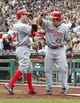 Sep 22, 2013; Pittsburgh, PA, USA; Cincinnati Reds third baseman Todd Frazier (21) is greeted by Reds catcher Ryan Hanigan (29) after Frazier hit a two run home run against the Pittsburgh Pirates during the first inning at PNC Park. Mandatory Credit: Charles LeClaire-USA TODAY Sports