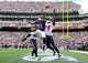 Sep 22, 2013; Baltimore, MD, USA; Baltimore Ravens wide receiver Torrey Smith (82) reaches for a pass while being defended by Houston Texans cornerback Johnathan Joseph (24) and safety Ed Reed (20) at M&T Bank Stadium. Mandatory Credit: Evan Habeeb-USA TODAY Sports