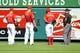 September 22, 2013; Anaheim, CA, USA; Los Angeles Angels center fielder Mike Trout (27), second baseman Howie Kendrick (47) and right fielder Kole Calhoun (56) point out bees to first base umpire Jim Joyce during the fourth inning against the Seattle Mariners at Angel Stadium of Anaheim. Mandatory Credit: Gary A. Vasquez-USA TODAY Sports