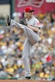 Sep 22, 2013; Pittsburgh, PA, USA; Cincinnati Reds starting pitcher Bronson Arroyo (61) pitches against the Pittsburgh Pirates during the third inning at PNC Park. The Reds won 11-3. Mandatory Credit: Charles LeClaire-USA TODAY Sports