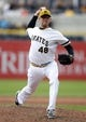 Sep 22, 2013; Pittsburgh, PA, USA; Pittsburgh Pirates relief pitcher Jared Hughes (48) pitches against the Cincinnati Reds during the ninth inning at PNC Park. The Reds won 11-3. Mandatory Credit: Charles LeClaire-USA TODAY Sports