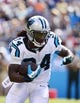 Sep 22, 2013; Charlotte, NC, USA; Carolina Panthers running back DeAngelo Williams (34) with the ball in the third quarter. The Carolina Panthers defeated the New York Giants 38-0 at Bank of America Stadium. Mandatory Credit: Bob Donnan-USA TODAY Sports