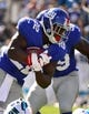 Sep 22, 2013; Charlotte, NC, USA; New York Giants running back David Wilson (22) runs in the fourth quarter. The Carolina Panthers defeated the New York Giants 38-0 at Bank of America Stadium. Mandatory Credit: Bob Donnan-USA TODAY Sports