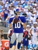 Sep 22, 2013; Charlotte, NC, USA; New York Giants quarterback Eli Manning (10) looks to pass in the third quarter. The Carolina Panthers defeated the New York Giants 38-0 at Bank of America Stadium. Mandatory Credit: Bob Donnan-USA TODAY Sports